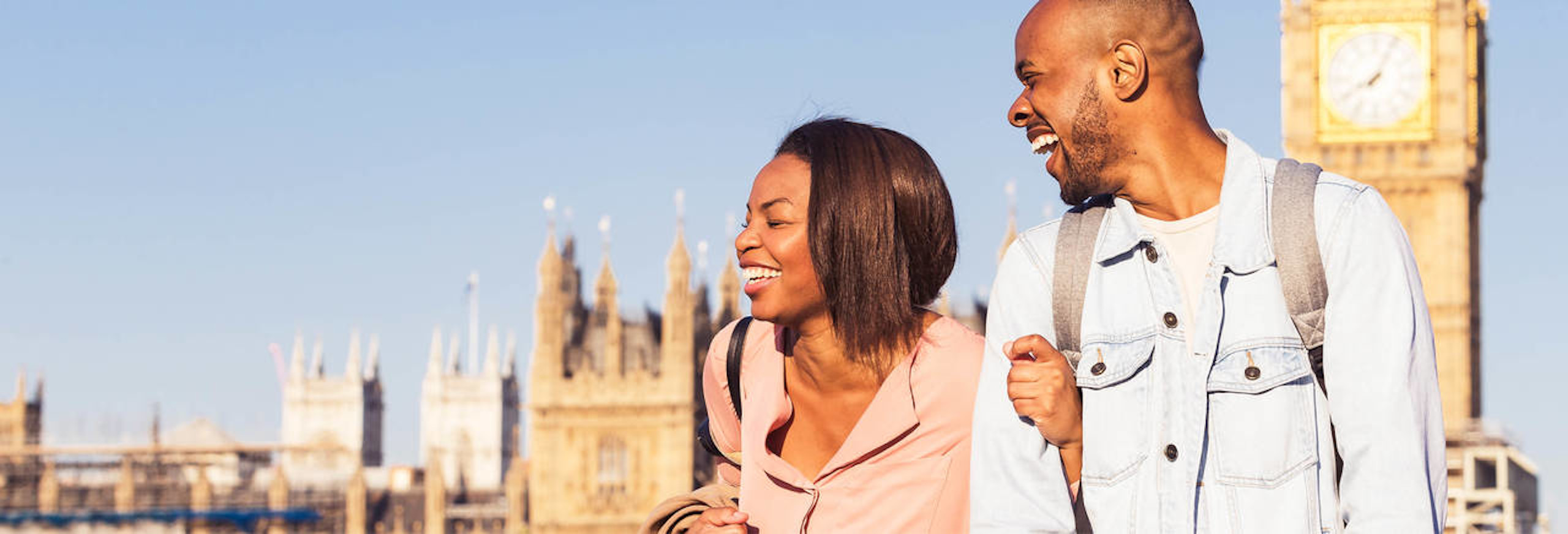 Couple walking by London Big Ben